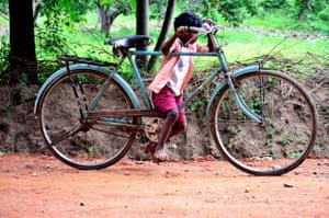 'This boy is trying to learn to ride a bike. This picture is taken on a sunday evening at Natham, a small town 20 miles away from Madurai city.'