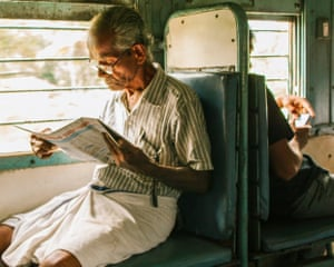 'A man reading on the train on the way to Kerela. In contrast, there is a young man behind him on his phone. A reflection on life and times.'