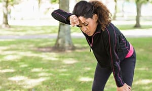 Tired woman jogging