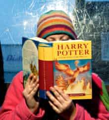 A child reading Harry Potter
