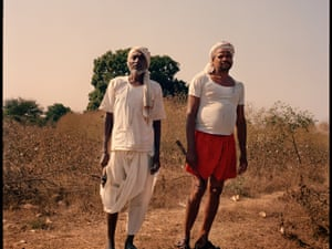Two farmers ready to harvest the cotton in a field in Yavatmal, Maharashtra, India