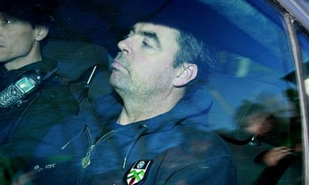 Seamus Daly arrives in a police car at Dungannon Court, Northern Ireland