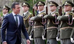 Nato secretary general Anders Fogh Rasmussen walks past a guard of honour at the Czech government HQ