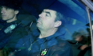 Seamus Daly arrives in a police car at Dungannon Court in Northern Ireland. He is charged with the murder of 29 people in the 1998 Omagh bombing.