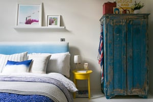 To Boldly Go - homes: bedroom with blue distressed cabinet and blue bed