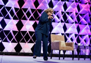 Former Secretary of State Hillary Clinton ducks after a woman threw an object at her while she was delivering remarks at the Institute of Scrap Recycling Industries conference in Las Vegas.