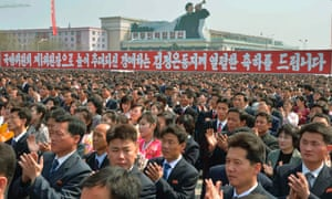 North Koreans celebrate the re-election of Kim Jong Un at an organised rally in Pyongyang.