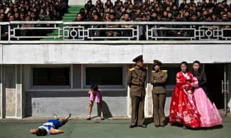 Runners rest in the Kim Il-sung Stadium after last year's Pyongyang marathon.