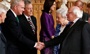 Ireland's President Higgins greets Northern Ireland's Deputy First Minister McGuinness