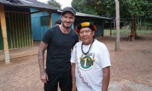 Ex-footballer David Beckham meets Yanomami leader Davi Yanomami.