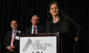 Investigative reporter Laura Poitras accepts the George Polk Award alongside Barton Gellman, far left, and Ewen MacAskill.