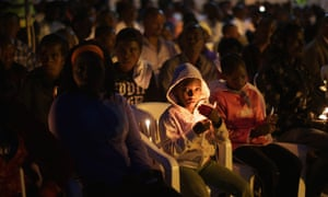 Thousands of people gathered for a candlelight commemoration ceremony the Nyanza-Kicukiro genocide memorial, 20 years after 2,000 people were killed in Kigali, Rwanda in 1994.