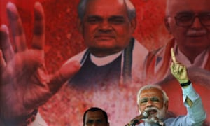 Narendra Modi addresses his supporters during a campaign rally at Balasore, India, on Friday.