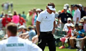Phil Mickelson looks disconsolate on the 18th green during the second round of the 2014 Masters