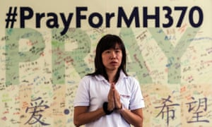 A Buddist offers prayers for the missing Malaysian Airline plane MH370 in Bentong, Pahang, Malaysia, on Sunday.