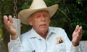 Rancher Cliven Bundy gestures at his home in Bunkerville, Nevada.