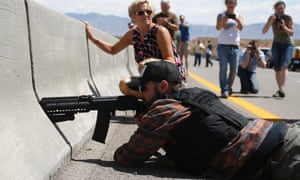 A protester aims his weapon from a bridge next to the Bureau of Land Management's base camp