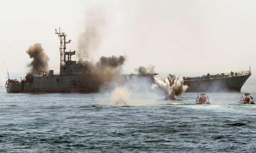 An Iranian warship and speed boats take part in a naval war game in the Persian Gulf.