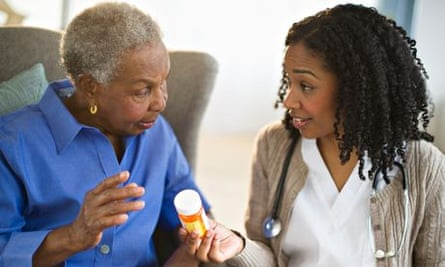 Doctor issuing medication to patient
