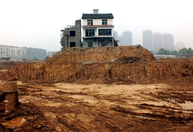 April 2013: Two nail houses left isolated on a construction site in Yichang, a city in central China's Hubei province