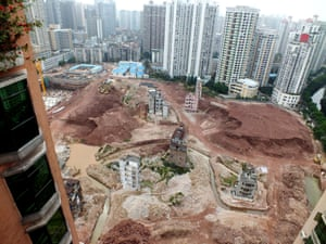 February 2013: Nail houses are isolated by man-made ditches on the construction site in Yangji village, Guangzhou city