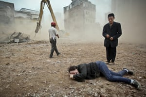 March 2012: A woman who tried to protect her house from being demolished cries at Yangji village in Guangzhou city.