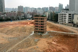 April 2007: A six-floor villa left on a construction site in Shenzhen. Choi Chu Cheung, the owner of the villa, and his wife Zhang Lian-hao, refused to accept the compensation offered by the developer who plans to build a financial centre on the site.