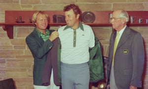 Jack Nicklaus presents Raymond Floyd with his green jacket as Cliff Roberts looks on