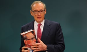 Former foreign minister Bob Carr holds a copy of  his new book.