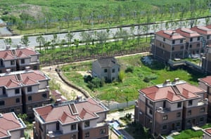A lone resident holds out against luxury villas in Suzhou, Jiangsu province