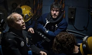 Two deep sea divers in a chamber, from the film Pioneer