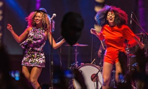 Singer Beyonce (L) performs with her sister Solange onstage during at Coachella