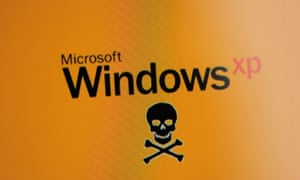 A black Microsoft Windows XP logo and a skull and crossbones pictured on a Surface tablet in the Microsoft store in Portland, Oregon on April 7th 2014.