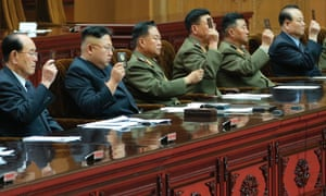 Kim Jong-un (second from left) attends the 13th Supreme People's Assembly on 10 April.