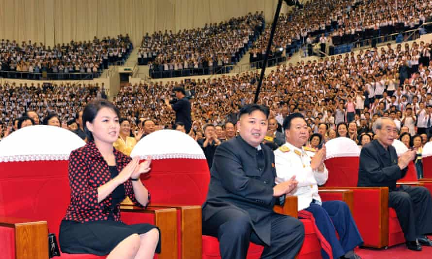 Kim Jong-un and his wife Ri Sol-ju attend a performance given by Moranbong Band in 2012. Picture released by North Korea's state news agency.
