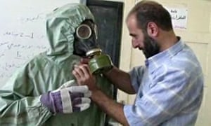 Syrian student is fitted in gas mask