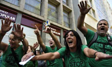 Activists of PAH (Mortgage Victims' Platform) protest against evictions outside a bank in Barcelona