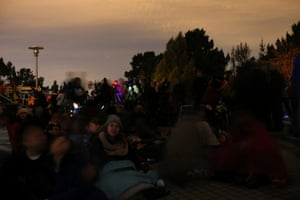 People gather at the Chabot Space and Science Center for a glimpse of the total lunar eclipse in Oakland, California.