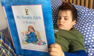 boy reads  My Naughty Little Sister book