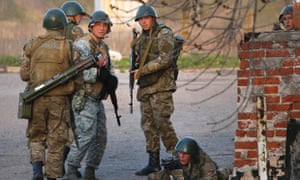 Ukrainian army troops set up a position at an airport in Kramatorsk, eastern Ukraine