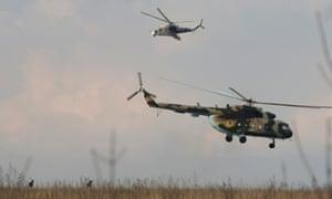 Ukrainian helicopters take off after delivering troops to an airbase in Kramatorsk, in eastern Ukraine April 15, 2014.