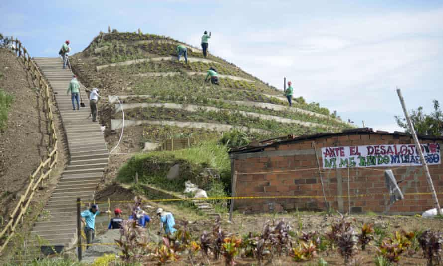 People work in Medellín's commune 4, where a mountain of garbage was converted into a  city park.