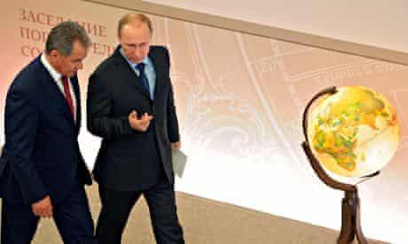 President Vladimir Putin with Russia's defence minister Sergei Shoigu.
