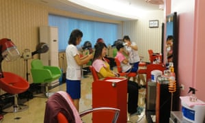 Women have their hair styled at a salon at Munsu Water Park in Pyongyang.