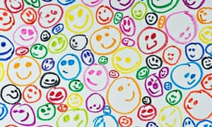 Wax crayon coloured drawing of happy smiling faces