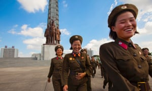 Female members of the Korean People's Army pose for photos in Pyongyang, North Korea.