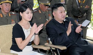 North Korean leader Kim Jong-Un (R) accompanied by his wife Ri Sol-Ju (C) visit to a sub unit of the Korean People's Army Unit 552