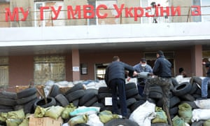 People building barricades outside the main police office in the town of Horlivka in the Donetsk region of eastern Ukraine.