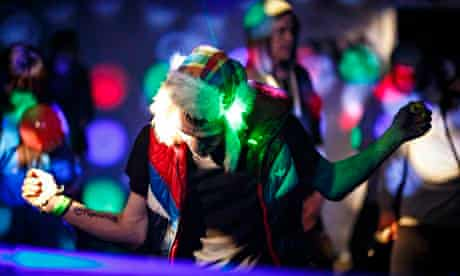 A man dances at an illegal rave in an abandoned warehouse in east London.