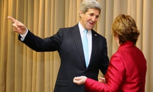 US Secretary of State John Kerry and EU foreign policy chief Catherine Ashton pose before a meeting on April 17, 2014 in Geneva